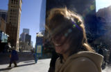 Yolanda Polky  is having a very hairy day in the wind at in downtown Denver, Colo. Monday February...