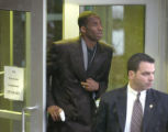 L.A. Lakers basketball star Kobe Bryant, left, leaves the Eagle County Justice Center after his...
