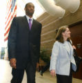 NBA star Kobe Bryant, left, and defense attorney Pamela Mackey arrive at the Justice Center in...