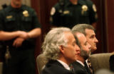 Michael Blagg, right, sits with his defense attorneys, from left, David Eisner and Ken Singer,...