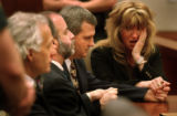 Michael Blagg, center, sits with his defense attorneys, from left, David Eisner, Ken Singer, and...