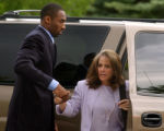 NBA star Kobe Bryant helps his defense attorney Pamela Mackey out of the vehicle as they arrive at...