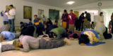Members of the Hindu Temple and Cultural Center of the Rockies in Littleton, Colo., pray Monday,...