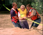 Colorado Park Ranger Russ Walsh, left, and Logan County Sheriff Deputy David Russell help Elsie...