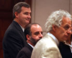 Standing while the jury enters the courtroom Thursday, March 25, 2004, in Grand Junction, Colo.,...