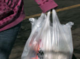 A plastic bag of groceries is carried out of Safeway at 20th and Federal on Wednesday February...