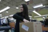 Carrie Ashton, 34, (cq) loads groceries into a box at Vitamin Cottage 11465 Washington Street in...