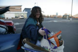 Tammie Martinez (cq) load her groceries into her car outside of Vitamin Cottage 11465 Washington...