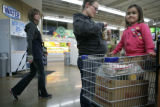 Kachina Ortiz (cq) checks out while her daughter Hailey, 2, (cq) waits in the cart at Vitamin...