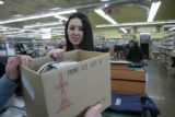 Carrie Ashton, 34, (cq) hands groceries sacked into a box to a customer at Vitamin Cottage 11465...