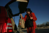 Cyndy Rhoadarmer (cq) carries her groceries from Vitamin Cottage 11465 Washington Street in...