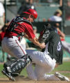 (0026) Luke Carlin tags out Carlos Gonzalez at home in the 7th inning of the Colorado Rockies...