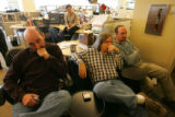 Employees of the Rocky Mountain News react on Thursday February 26, 2008 in Denver, Colorado, to...