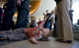 Ryan Hammer, 2 plays with his airplane as adults conduct a press conference that would cover...