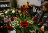 (PG0714) Freelance floral designer Jan DesMarteau (cq) works on arrangements for Valentine's Day...