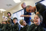 (257) Fifth grade teacher Jesica Harrington (cq), shaves the head of her student Sam O'Rourke,...