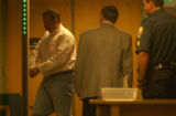William DeMarco leaves Garfield County District Court on Wednesday October  19,2005 after yelling...