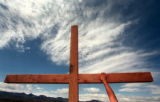 RMN 203  5-2-99  A HAND REACHES OUT FOR A CROSS THAT WAS PLACED ON A HILL TOP SUNDAY AT COLUMBINE...