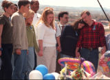 RMN109 4-27-99 Littleton,Colorado: A crowd gathered atop a hill next to Columbine high school and...