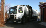 Mark Duran Sr. (cq) carefully turns a  trash truck for Denver's Department of Public Works Solid...