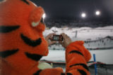 Scott Bradford (cq) of Pagosa Springs, Colorado takes a photo during the Winter X games at...