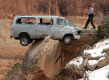 PHOTO BY CHRISTOPHER TOMLINSON--A Ranger with the Colorado Nation Monument checks on a van that...