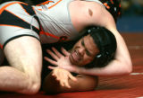 0043(171lbs) Greeley Central's Brice Wolf, top, dominates Thompson Valley's Joe Chavez, bottom,...