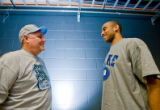 0287 Nuggets head coach George Karl, left, a UNC grad, and guard Dahntay Jones, right, a Duke...