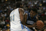 Nene of the Denver Nuggets guards against Ronnie Price (cq) of the Utah Jazz during the first...
