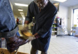 DM0451  Phil Baugh, 62, shines Jim Rice's shoes at Baugh's stand set up in the waiting area at the...
