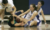 562  5A girls basketball: Thunder RidgeBrooke Jelniker, bottom holds on while Highlands Ranch,...