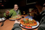 133  Heather McCarthy, and her boyfriend Ryan Oakes, enjoy their heart shaped pizzas while on a...