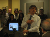 Rocky Mountain News staffers listen to Editor/Publisher John Temple during his weekly Thursday...