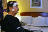 At the Sleep Center at National Jewish Brett Bartling, sleep technician attaches sensors to Cindy...