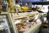Store owner, Anatoly Portnoy (cq), works at the counter at his St. Petersburg European Grocery and...