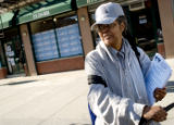 Rev. Leslie McHenry of the Bronx exists Obama headquarters in Harlem after picking up campaign...