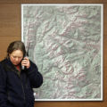 National Park Service Wildlife Veterinarian Dr. Jenny Powers calls researchers in the field to...