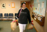 Sarah Leggett leaves, CareRing, with some food and other items, Friday afternoon, January 18,...