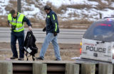 Littleton Police remove  a child's car seat from  the scene of a crash on C-470 near Santa Fe...