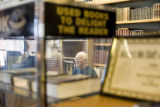 Bob Benham (cq), store owner of Book World,  sits amidst his collection of books on Jan. 22, 2008,...