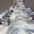 PHOTO SPECIAL TO THE ROCKY MOUNTAIN NEWS GLENWOOD SPRINGS - Ernest Gerbaz, 77, walks in a snow...