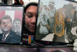 Berilyn Borne holds photos of MLK, JFK, and Malcolm X as she joins other marchers at Civic Center...