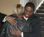Terrance Carroll (D) HD 7, gets a hug from Buffie McFadyen (D) HD 8, after being elected by the...