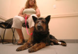 (DENVER, CO, JUNE 14, 2004)  Claudia Torres sits with in an exam room at Alameda East Veterinary...
