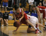 Regis' #15 Megan O'Neil passes to a teammate with Highlands Ranch's Taylor Johnson getting tripped...