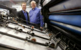 Ira Johnson, Dir. of Sales, left, and Dan Linn, owner of BC Printing Inc. stand next to a...