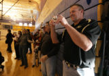 Parents of new recruits like dad, Brian Givens takes a picture of a group of students at Mullen HS...
