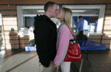 After signing for Mesa State Caleb Pavy gets a congratulatory kiss from girlfriend Molly Mitchell...