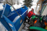 (Avon, Colo., Jan. 19, 2008) Joe Histed fills the water tank on a small, tractor-driven Zamboni...