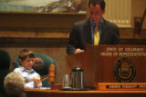 William Joslin (cq), age 7, bangs the gavel as Speaker of the House Andrew Romanoff (cq) D-Denver ...